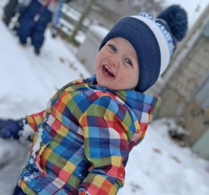 saline preschool student playing outside in the snow