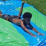 child on slip n slide