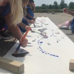 B2 Camp painting outside
