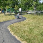 children excercising outdoors on bike path