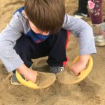child playing with sand outdoors