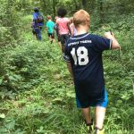 children learnig about nature in an outdoors hiking trail