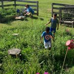 children setting up fairy garden in their outdoor learning environment