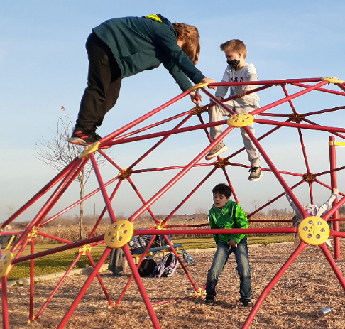 school age children playing on lincoln schools playground