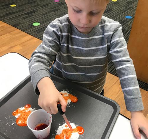 preschool child in saline using a chemistry kit