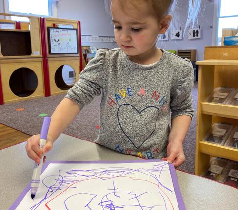 saline preschooler making art in class